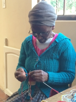 This is our first community knitter learning to make her bear. Her name is Lephina Zondi.
