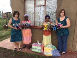First National Bank handing over their donation of wool to our knitters